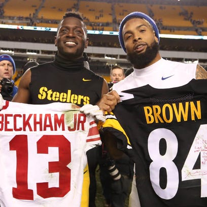 Steelers wide receiver Antonio Brown, left, and Giants wide receiver Odell Beckham exchange jerseys after their game at Heinz Field.