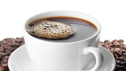 Stock image of coffee cup and beans.