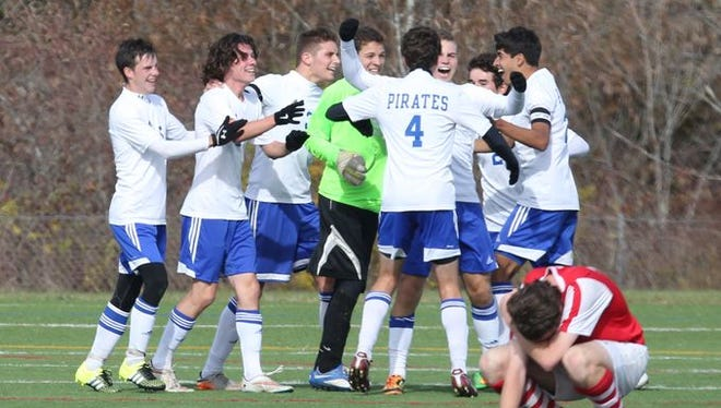 Pearl River celebrate their win as Tappan Zee's Eoghan McGee shows his dejection after scoring a second goal during action in the Section One Class A boys final at Arlington High School, Oct. 31, 2015.