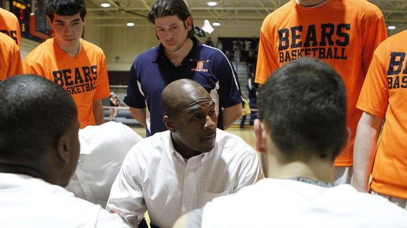 Coach Cody Moffett talks to his team during Briarcliff's
