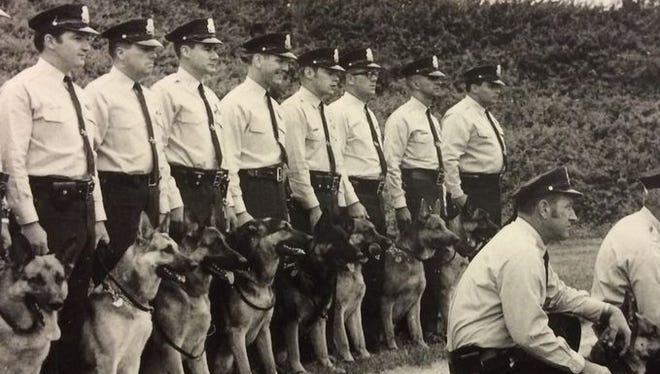 Ronald Heist , third from right, is seen as a member of the York City canine unit in May 1969. Heist was working for Schaad Detective Agency of York, a contractor for the Pennsylvania Turnpike, when he was shot March 20.