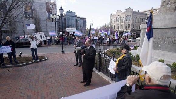 Supporters of HB2 demonstrate Saturday at Pack Square in the foreground while opponents hold a counter-demonstration in the background
