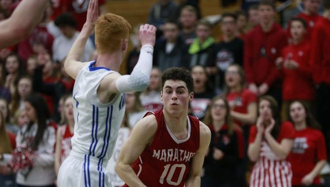 Marathon guard Cameron Schilling is guarded by Auburndale's Cooper Weinfurter during a WIAA Division 4 sectional semifinal at D.C. Everest.