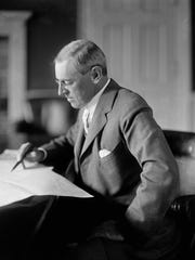 "President Woodrow Wilson, who'd campaigned for president in 1916 opposing U.S. entry into World War I, led his nation into the war in 1917. He said it would ""make the world safe for democracy.'' And he was associated with the claim that the conflict was ""a war to end all war.''"
