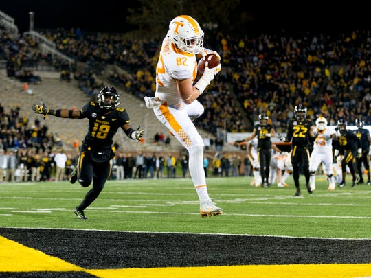 Tennessee tight end Ethan Wolf (82) lands in the end zone for a touchdown after catching a pass from Tennessee quarterback Will McBride (17) during a game between Tennessee and Missouri at Faurot Field in Columbia, Missouri, on Saturday November 11, 2017.