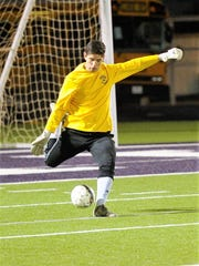Wylie goalkeeper Cameron Dawsey (0) punts the ball during the Bulldogs' 1-0 victory against Mineral Wells at Bulldog Stadium on Tuesday, March 6, 2018.
