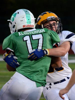 Novi's Kyle Klosterman had a 100-yard rushing night in the Wildcats' 14-7 victory over Hartland on Friday night.