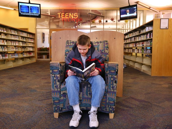 Ethan Michael, 11, Greenfield, reads a graphic novel,