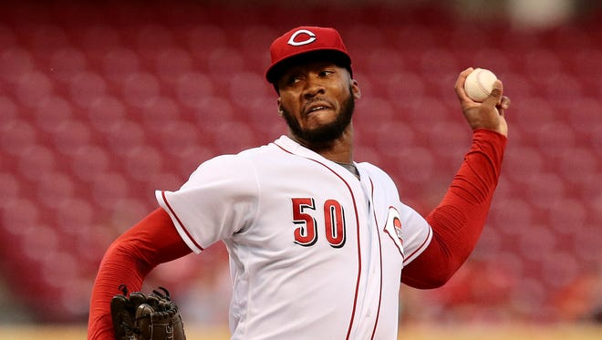Cincinnati Reds starting pitcher Amir Garrett (50) delivers a pitch in the top of the third inning.
