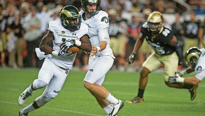 Receiver Anthony Hawkins takes a handoff from quarterback Faton Bauta on an end-around play during a Sept. 2 game against the University of Colorado in Denver. CSU coach Mike Bobo said he's had to dig deeper into his playbook this season in an effort to get the ball more often to play-makers like Hawkins.