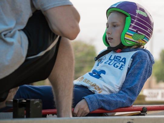 Gabriella Deer, 11, readies herself for a luge run.