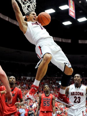 Arizona Wildcats guard Nick Johnson (13) dunks the ball during the second half against the Utah Utes at McKale Center. Arizona won 65-56.