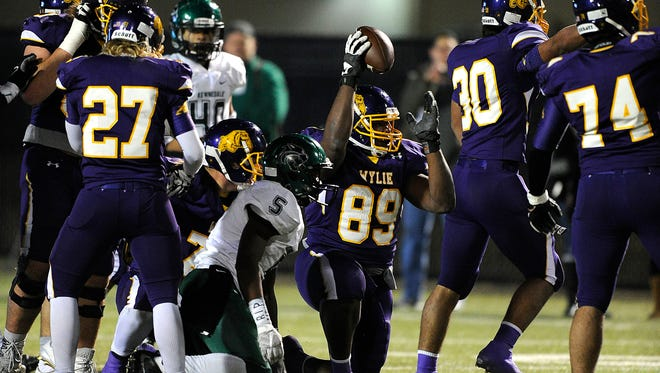 Wylie defensive end Dion Novil (89) celebrates after recovering a fumble in the third quarter of the Bulldogs' 21-13 win in the Class 4A Div. I state semifinal playoff on Friday, Dec. 9, 2016, at Birdville Fine Arts/Athletics Complex.