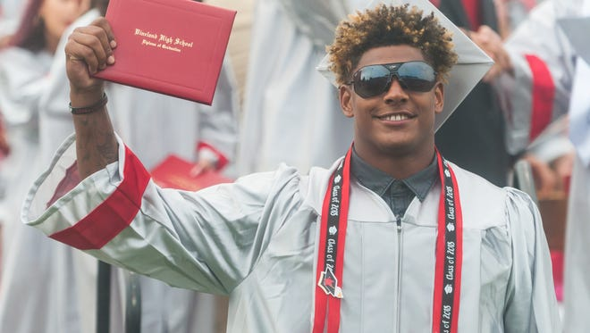 One of 685 Vineland graduates receieves their diploma during Vineland High School Graduation at Gittone Stadium on Wednesday, June 20.