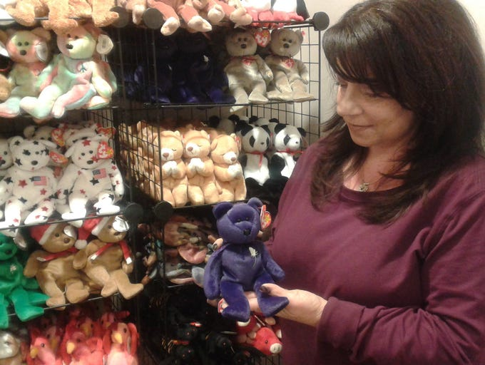 Dawn Melonio looks over Beanie Babies in her new store,