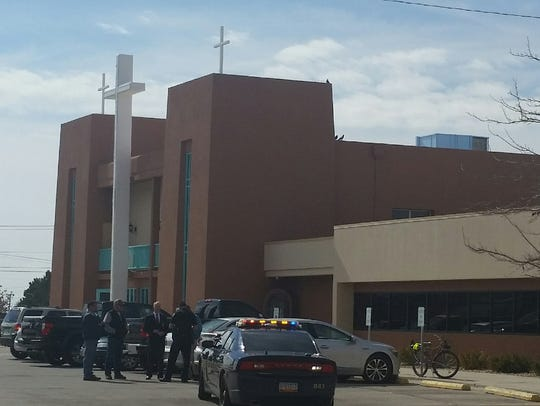 Las Cruces police talk with Mass attendees at St. Genevieve