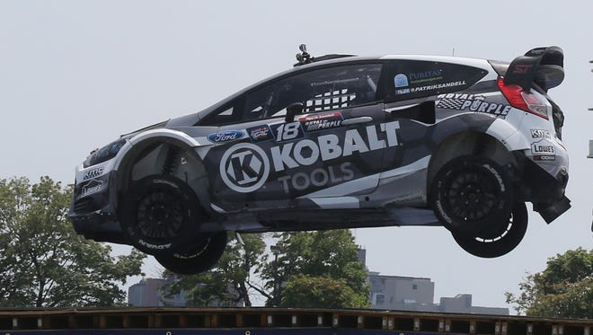 Patrik Sandell goes over the jump during the finals of the Red Bull Global Rallycross on Belle Isle Saturday.