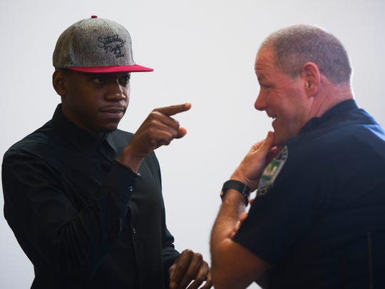 Chris Blue, winner of NBC's 'The Voice' season 12 speaks to Knoxville Police Chief David Rausch at the Save our Sons Summit II before talking to attendees at Pellissippi State Community College's Magnolia campus on Friday, June 30, 2017. Save Our Sons works with the community to address  gaps in opportunity and to end violence-related deaths among boys and young men of color.
