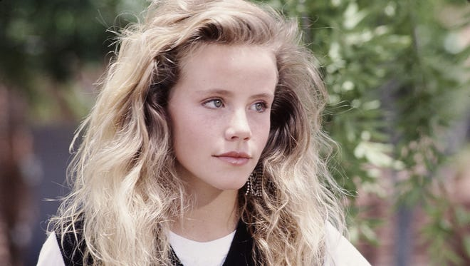 """This undated photo provided by Disney shows actress Amanda Peterson in """"Can't Buy Me Love."""""""