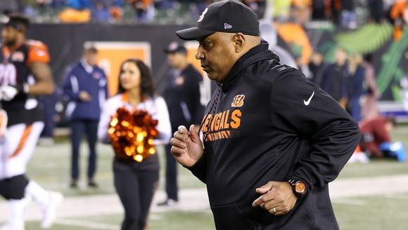 Cincinnati Bengals head coach Marvin Lewis jogs off