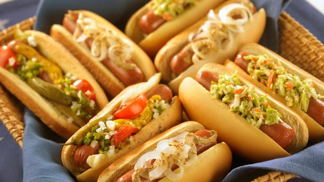 Hot dogs can be loaded with a host of toppings. Americans will eat 7 billion dogs this summer.