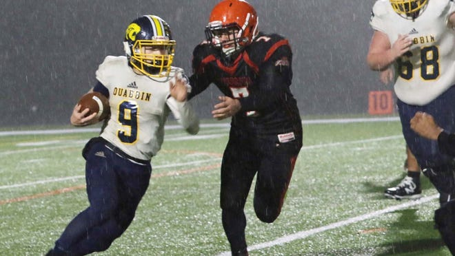During his senior season with the Quabbin Regional football team, Noah Herzig (9) set the program's rushing record with 973 yards. A three-sport athlete, Herzig also competed on the Quabbin wrestling and boys' outdoor track teams. [Mike Cormier/TGN File Photo}