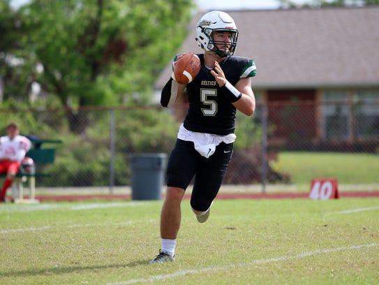 St. John Neumann quarterback Jensen Jones looks for