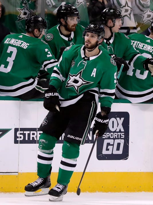 Dallas Stars center Tyler Seguin (91) celebrates with the bench after scoring against the Toronto Maple Leafs in the second period of an NHL hockey game Thursday, Jan. 25, 2018, in Dallas. (AP Photo/Tony Gutierrez)