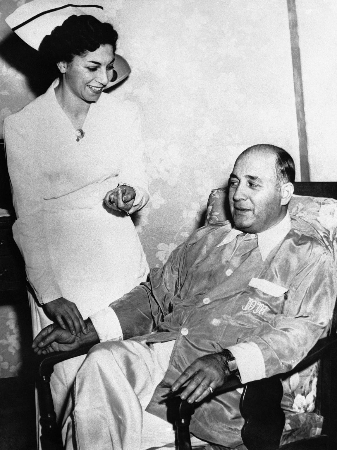 Willie Moretti said on Oct. 14, 1950 at St. Mary's Hospital in Passaic, New Jersey, that he is ready to tell the Senate Crime investigating committee all he knows about the rackets-which he says is nothing. He is shown ready to leave the hospital. With him is his nurse Mrs. Marie Puzio.