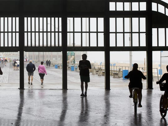 Asbury Park visitors ride bikes, jog and walk through