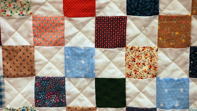 This file photo shows a patchwork quilt.