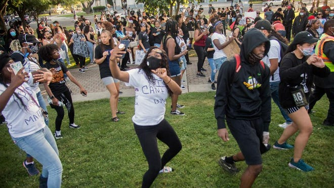 Protesters perform an impromptu group dance at the end of their demonstration Monday evening at Dr. Martin Luther King Jr. Plaza in downtown Stockton against the death of George Floyd while in the custody of four police officers in Minneapolis last week.