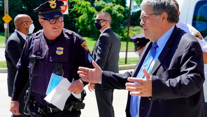 In this Thursday, Aug. 20, 2020, photo Attorney General William Barr addresses officers with the Cleveland Police Department about Operation Legend during a visit to the city in Cleveland.