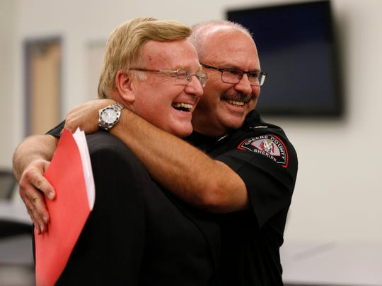 Springfield Mayor Ken McClure and Greene County Sheriff Jim Arnott jokingly hug after a press conference announcing the city and county have reached an agreement on the jail dispute on Friday, July 28, 2017.