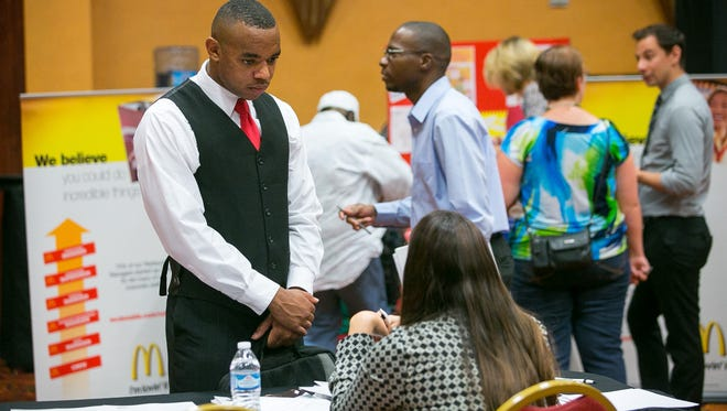 Avery Boykin, left, talks with recruiter Heather Jansen at a job fair at Renaissance Glendale Hotel and Spa on Aug. 31, 2015.