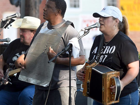Amy Nicole and Zydeco Soul entertain at Saturday's Zydeco Breakfast in downtown Opelousas.