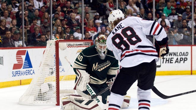 Chicago Blackhawks forward Patrick Kane (88) scores on Minnesota Wild goalie Devan Dubnyk (40) during the first period in game three of the second round of the 2015 Stanley Cup Playoffs at Xcel Energy Center.