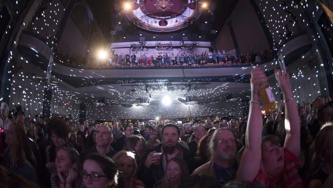 Music fans cheer on the rotating cast of local musicians at last year's Shine a Light concert at World Cafe Live at the Queen in Wilmington.