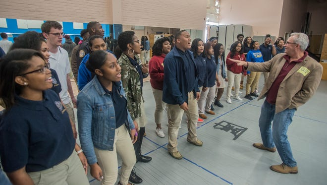 Montgomery native Tommy Jackson, founder and owner of Rising Star Road Show and First Note Entertainment, speaks to the Booker T. Washington Magnet High School Choir as they rehearse on Friday, Feb. 9, 2018. The choir will perform Saturday during the Rising Star Road Show at the Montgomery Performing Arts Centre.