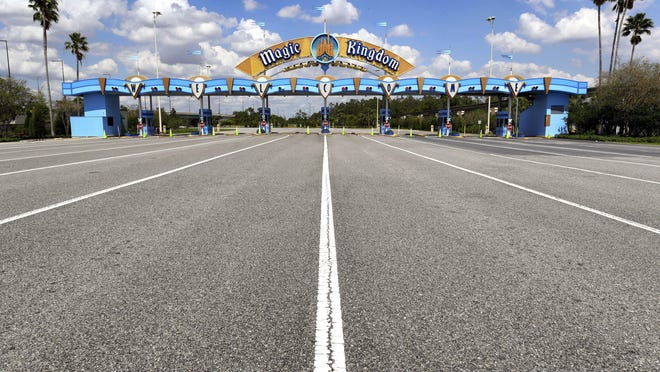 All is quiet at the parking plaza entrance to the Magic Kingdom as Walt Disney World enters its second week of being shut down in response to the coronavirus pandemic,Tuesday, March 24, 2020.