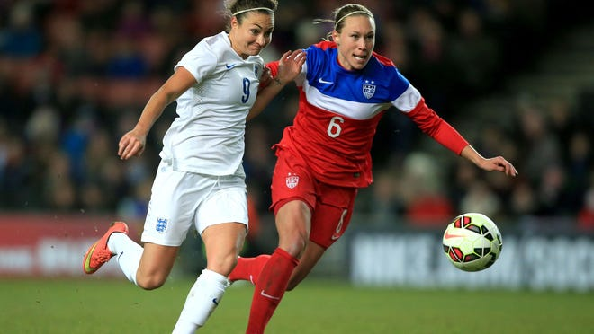 Defender Whitney Engen, right, shown playing for the U.S. squad last fall, is expected to be a key leader with the Flash after returning from the World Cup.