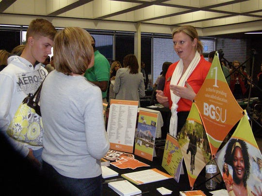 Parents and students attend a Coshocton CARES college fair.
