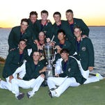 The vicorious United States team poses with the Walker Cup after Day Two of the 2013 Walker Cup at National Golf Links of America on September 8, 2013 in Southampton, New York.