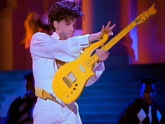 636024844067488634-US-Prince-Guitar-John.jpg