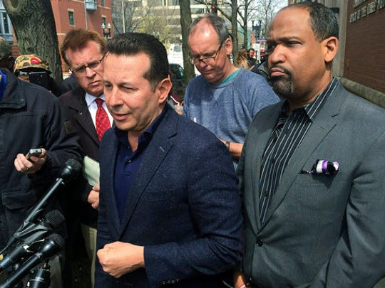 "Attorneys Jose Baez, left, and Ronald Sullivan, who successfully defended former New England Patriots player Aaron Hernandez in a double-murder case, hold a briefing outside the state medical examiner's office, Thursday, April 20, 2017, in Boston. Baez accused Massachusetts' chief medical examiner of ""illegally"" holding the brain of the ex-NFL star, who was found Wednesday hanged in his prison cell. Baez said Hernandez's family had arranged for Boston University to study the former tight end's brain as part of its concussion research."