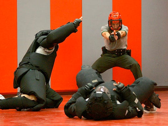FILE - In this April 5, 2007, file photo, Border Patrol agent recruits practice self defense drills at the Border Patrol Academy in Artesia, N.M. U.S. Customs and Border Protection, the parent agency of the Border Patrol and of Office of Field Operations, is taking steps to hire more agents and customs officers. President Donald Trump has ordered 5,000 new Border Patrol positions.