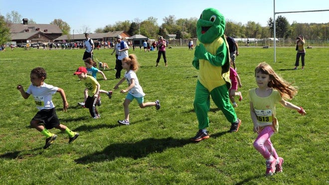In this file photo, runners take part in the kids 100-yard dash at the 2014 Wa Wa Wally Waddle.