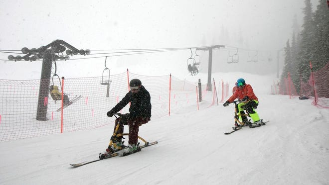 From April 10, 2019, riders on ski-bikes participating in the 30th Annual Enduro, a fundraiser and ski-a-thon to benefit a local cause, heads towards base of Pallavicini Chair at Arapahoe Basin Ski Area, Colo. The ski resort will open for limited spring skiing and riding on Wednesday, May 27, 2020. This follows approval of Summit County's request for a variance from the state public health order by the Colorado Department of Public Health and Environment. At this time, closing day is still to be determined.