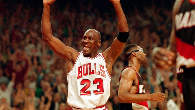 From June 14, 1992, Michael Jordan celebrates the Bulls win over the Portland Trail Blazers in the NBA Finals in Chicago. Decades after Jordan's groundbreaking departure from college, March Madness and the NBA's mega-millions have taken all the novelty out of leaving early for the pros.