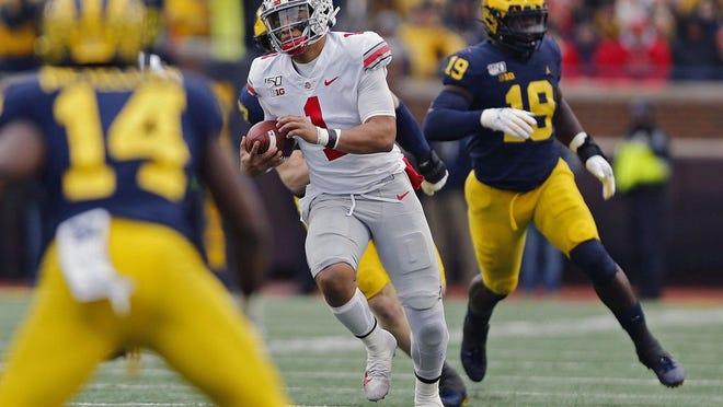 Ohio State  quarterback Justin Fields runs against Michigan on Nov. 30 in Michigan Stadium.